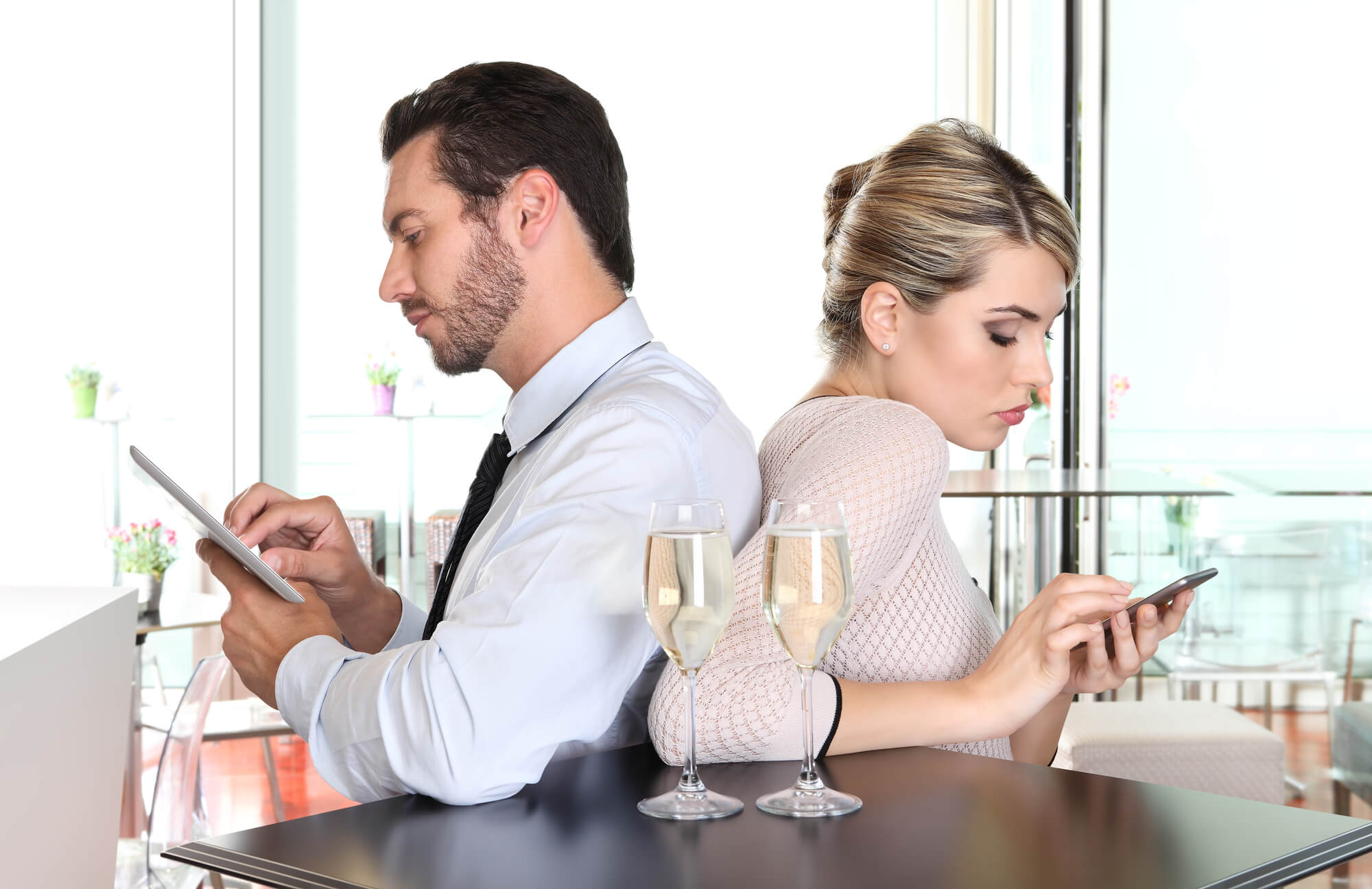 Couple back to back at bar